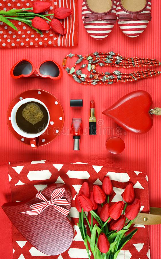 Red feminine accessories travel shopping planning packing concept flatlay. Red feminine accessories travel shopping preparation concept with shoes, bag, scarf stock image