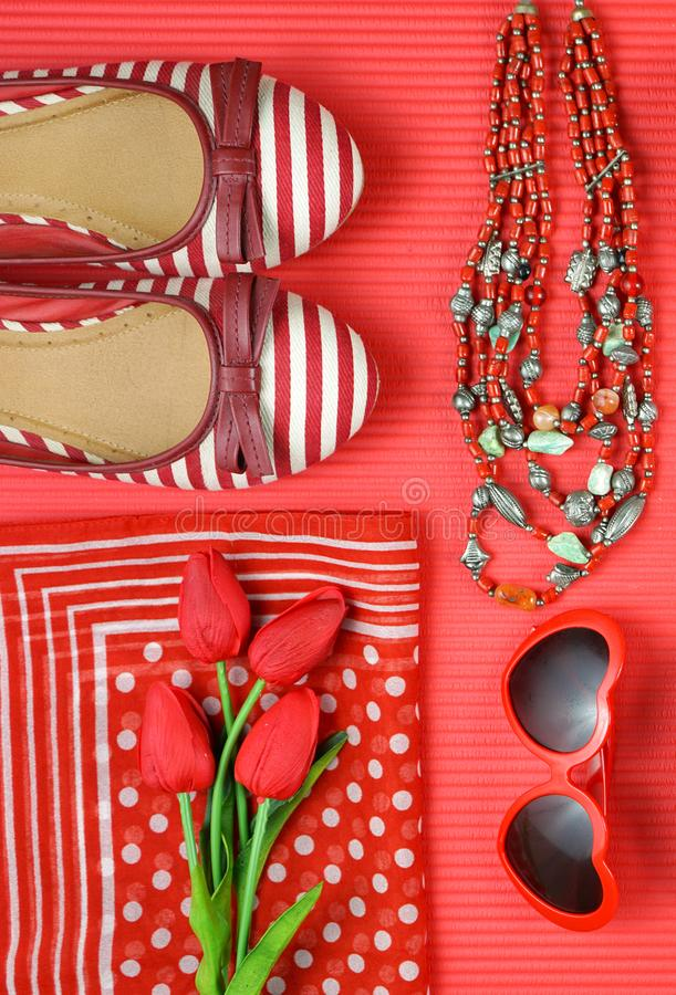 Red feminine accessories travel shopping planning packing concept flatlay. Red feminine accessories travel shopping preparation concept with shoes, bag, scarf stock photography