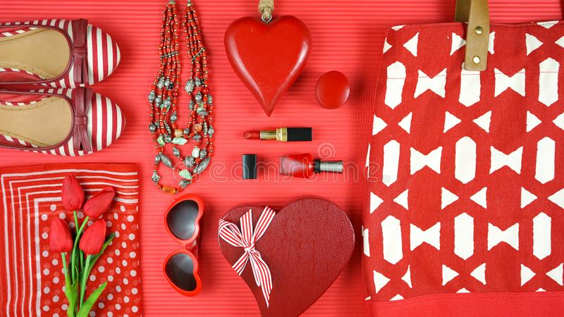 Red feminine accessories travel shopping planning packing concept flatlay. Red feminine accessories travel shopping preparation concept with shoes, bag, scarf stock images