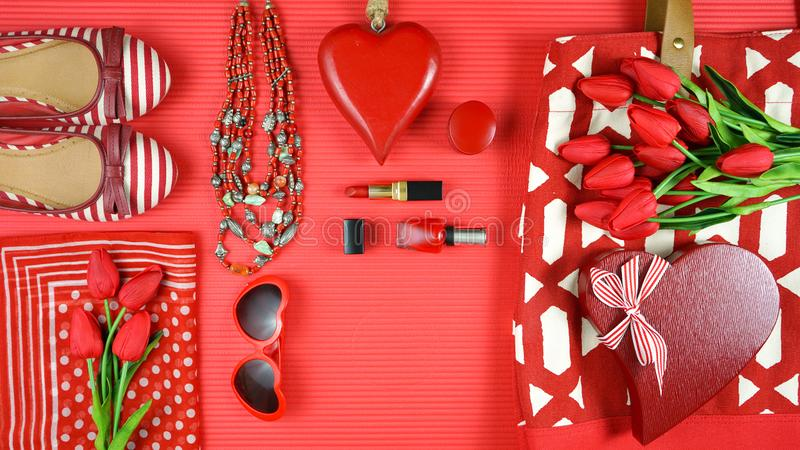 Red feminine accessories travel shopping planning packing concept flatlay. Red feminine accessories travel shopping preparation concept stop motion with shoes royalty free stock photos