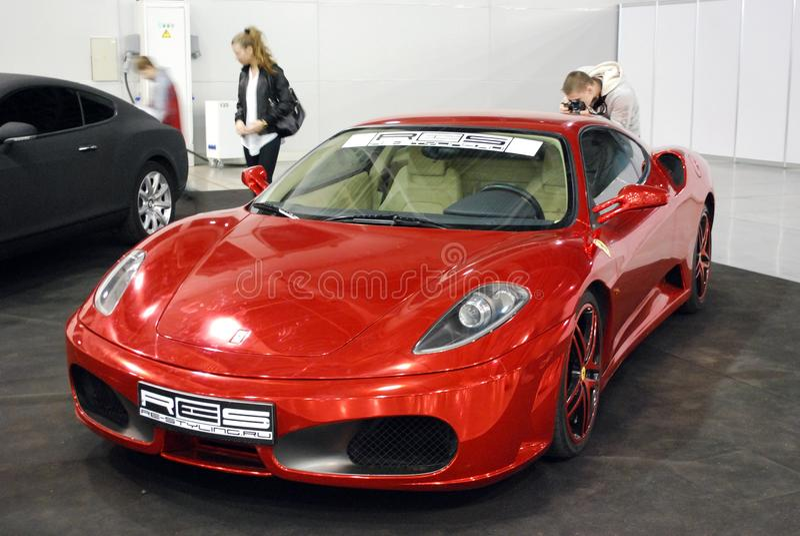 Red `Ferrari 430` in `Crocus Expo 2012` stock photos