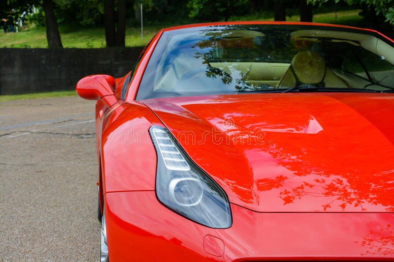 Red Ferrari. A 2015 Ferrari on the road with countryside background royalty free stock image
