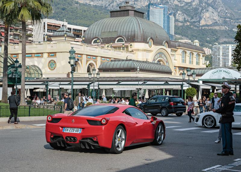 Red Ferrari sports car near the entrance to the casino Monte Carlo. Monte-Carlo, Monaco - 2 NOVEMBER, 2014: Red Ferrari sports car near the entrance to the royalty free stock photo