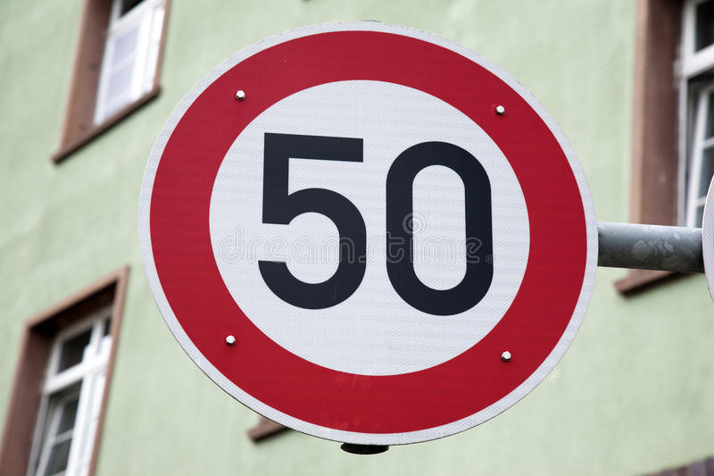 Red Fifty Speed Sign stock photos