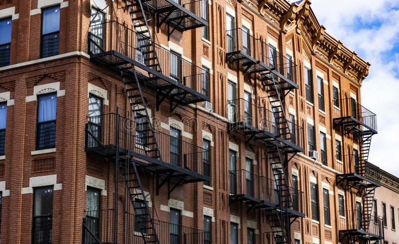 Red Fire escape stairs-downtown back alley architecture-steel and red brick background. Red Fire escape stairs-downtown back alley architecture-steel royalty free stock photography