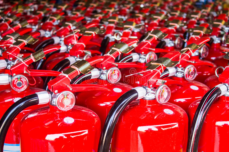 Red fire extinguishers. Available in fire emergencies royalty free stock photo