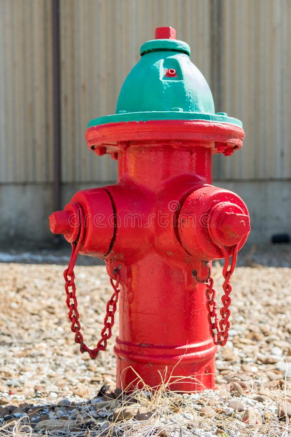 Red fire hydrant with green top stock image