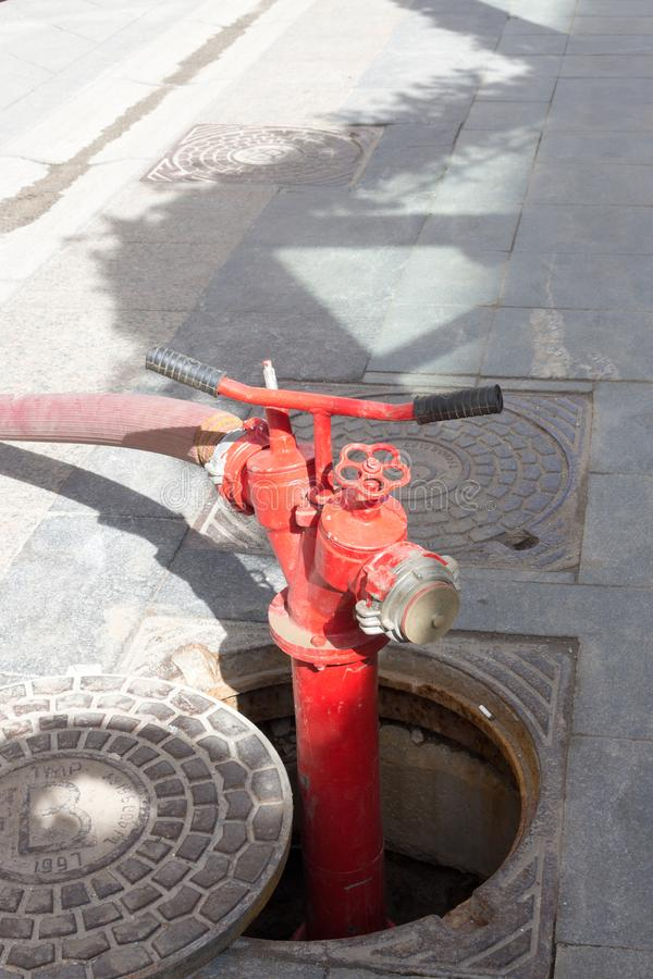 Red Fire Hydrant in Moscow. A fire hydrant, fire pump, johnny pump, or simply pump, is a connection point by which firefighters can tap into a water supply stock image