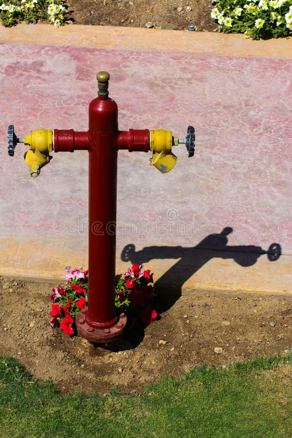 Red fire hydrant with yellow connectors. Fire hydrant or fire pump, represents the point of connection, through which firefighters. Can enter the water supply stock photos