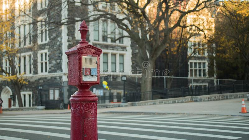 Red fire and police alarm street call box stock photo
