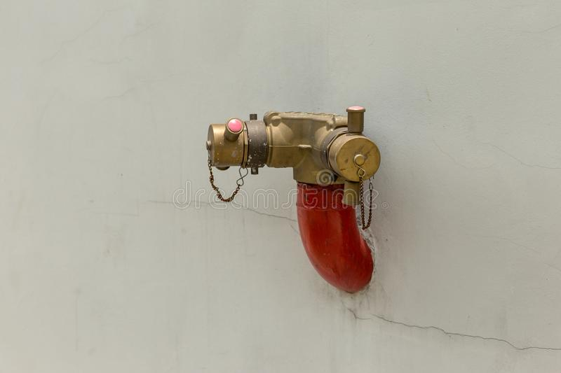 Red fire pump in front of concrete wall. fire safety pump on cement floor of concrete building. Deluge system of firefighting syst royalty free stock photos