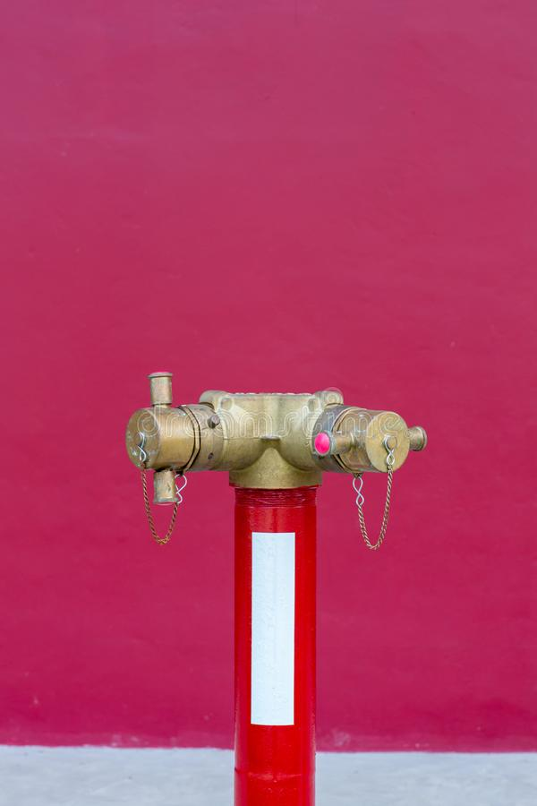 Red fire pump in front of concrete wall. fire safety pump on cement floor of concrete building. Deluge system of firefighting syst. Em. Plumbing fire protection stock photography