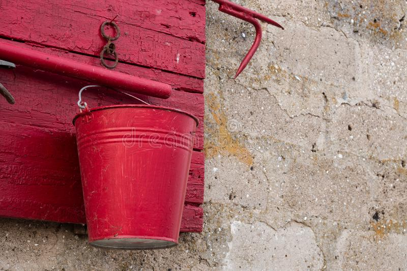 Red fire shield on a stone wall.  stock images