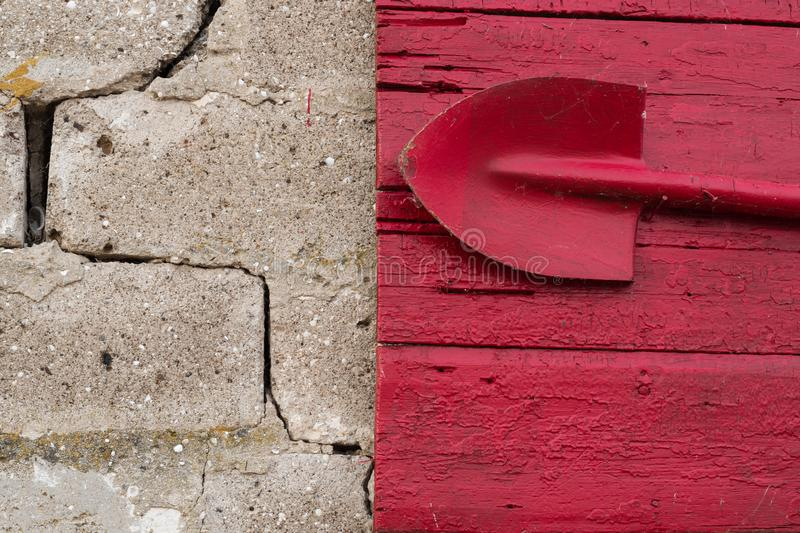 Red fire shield on a stone wall.  stock image