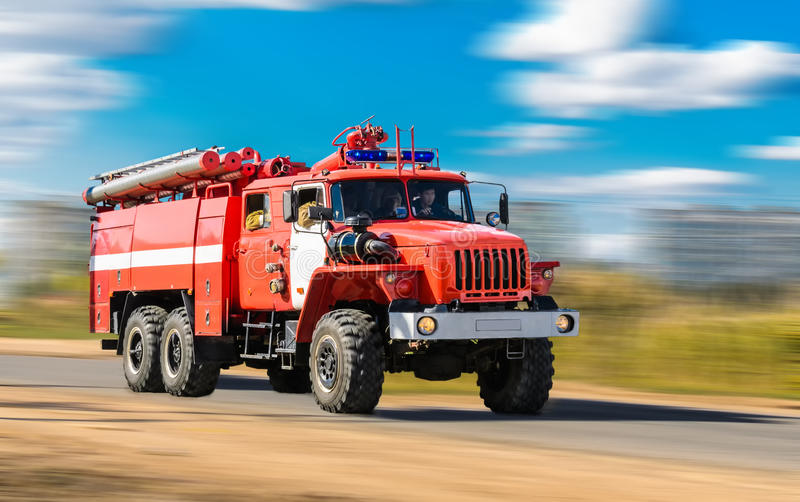 Red fire truck. Rushing down the street to the rescue stock images