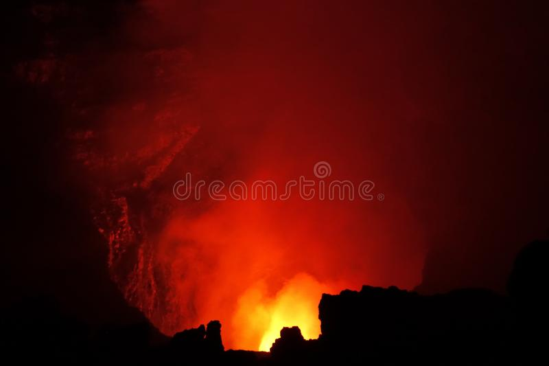 Volcano Fire in the Hole. The red fire of a volcano as seen at nighttime royalty free stock image