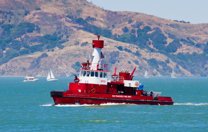 Red fireboat sailing in San Francisco bay royalty free stock photography