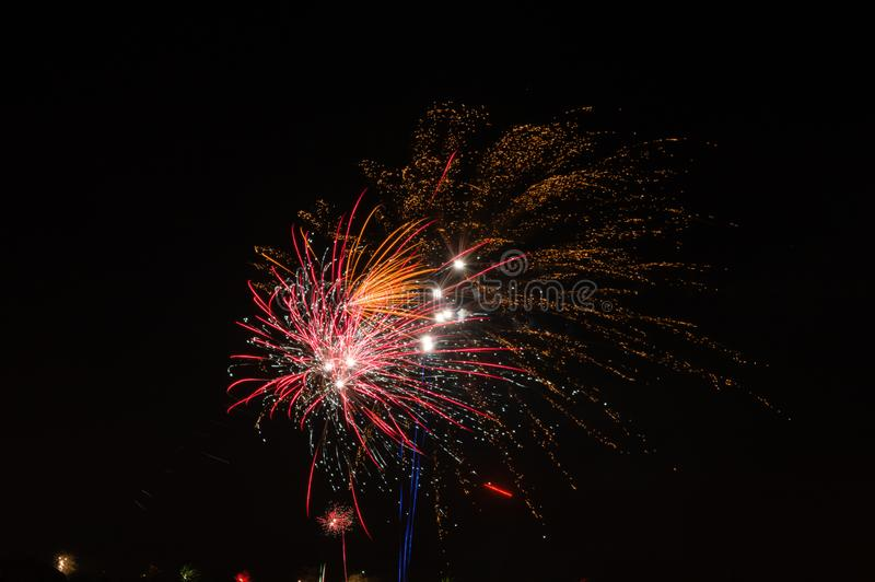 Red and fireworks display. At night royalty free stock photos