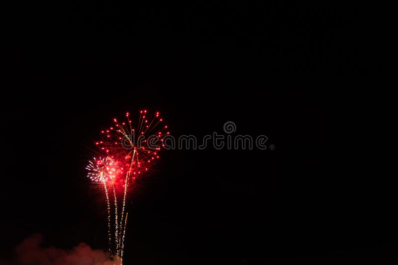The Red Fireworks. Red Fireworks Labor Day Celebration. July 4th. Independence Day. Night. New Years Eve royalty free stock photo