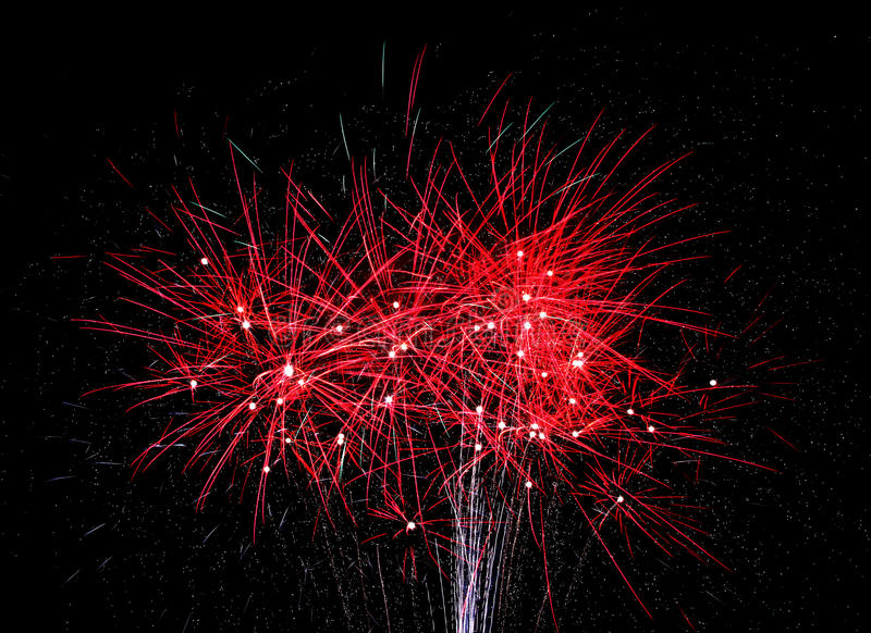 Red Fireworks light the sky on the 4th of July. Red Fireworks explode in the night royalty free stock images