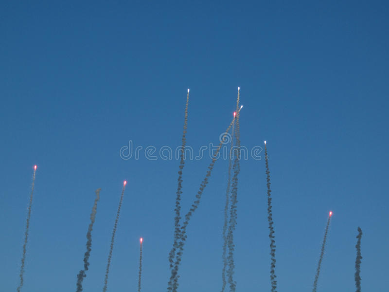 Red Fireworks soar into the air stock image