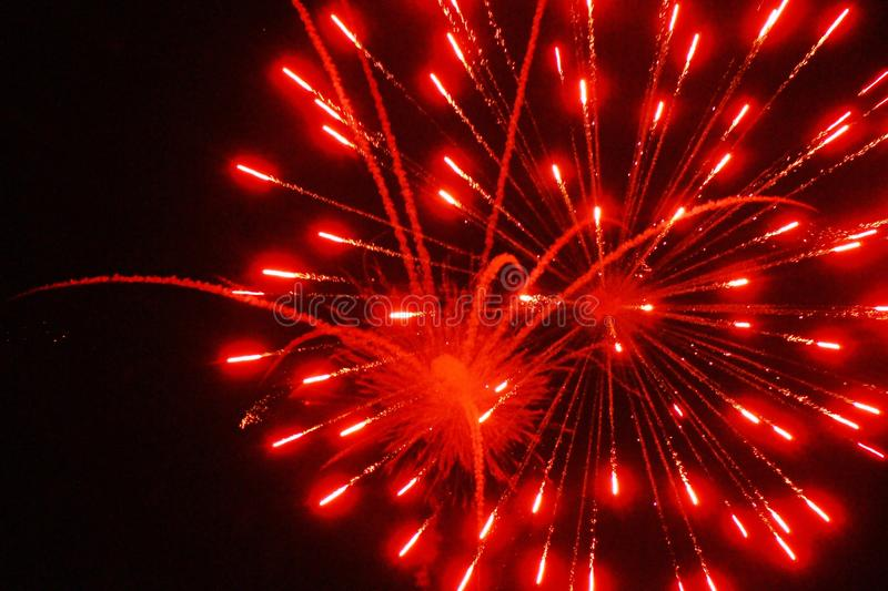 Red Fireworks. Fireworks were invented in ancient China in the 7th century to scare away evil spirits, a natural application of gunpowder, one of the Four Great royalty free stock image