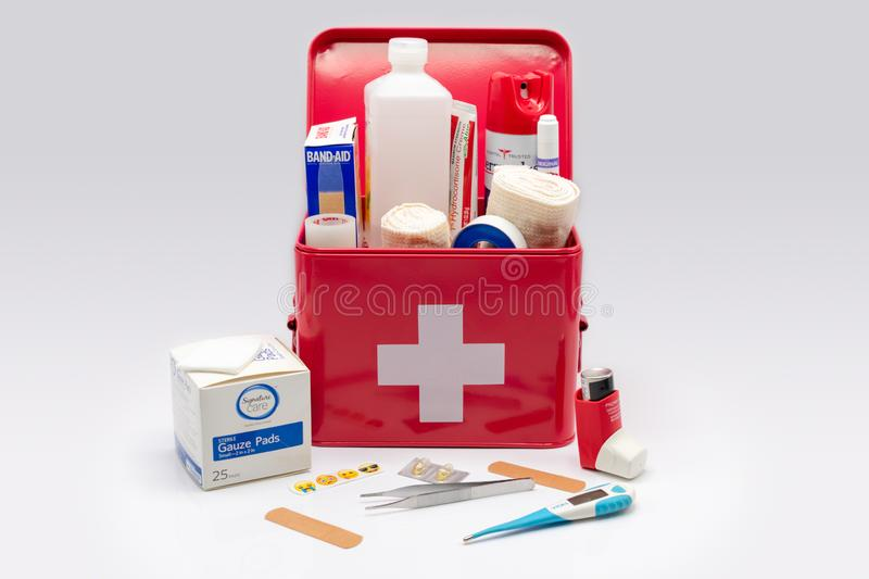 Red first aid kit with supplies royalty free stock photo