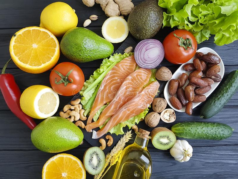 salmon fish, avocado organic raw green dietary on a wooden healthy food assorted royalty free stock photography