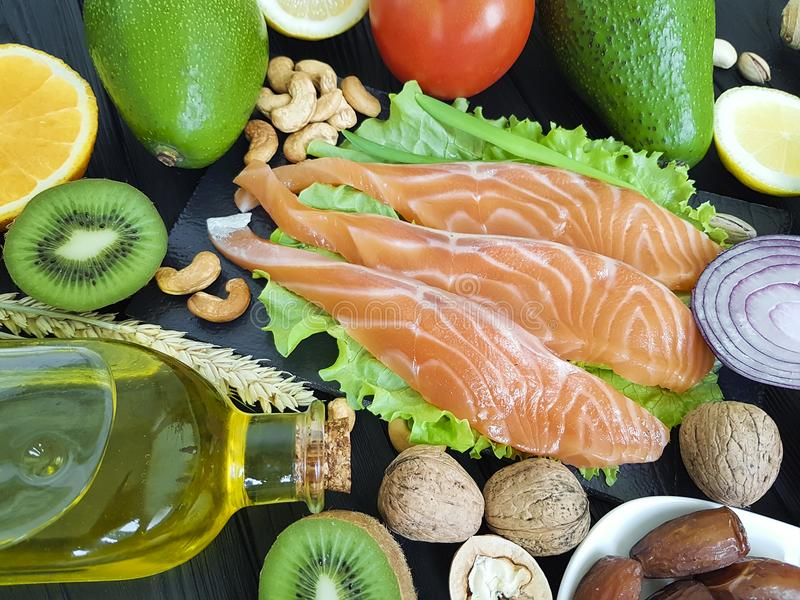 Salmon fish, avocado organic dietary on a wooden healthy food assorted. Red fish salmon, avocado on wooden healthy food dates assorted organic dietary stock photography