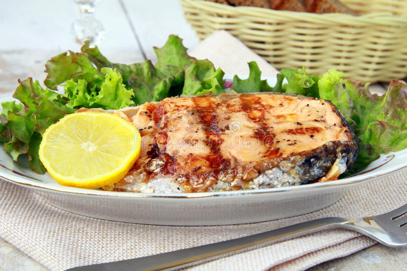Download Red Fish Salmon Grilled With Lemon Stock Photo - Image of grease, lettuce: 19585952