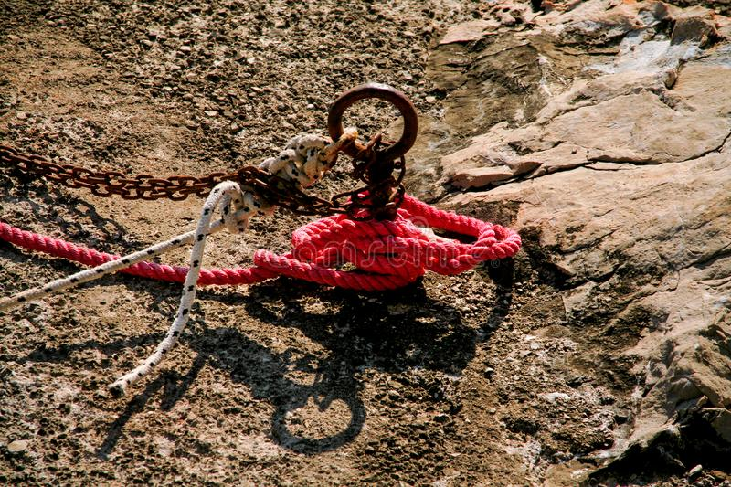 Red fisherman rope tied to a hook, close up royalty free stock photography