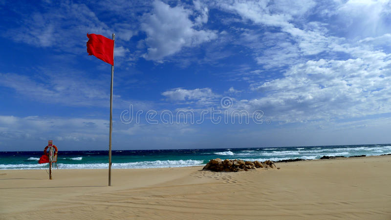 Red flag in Fuerteventura canary island spain stock photo