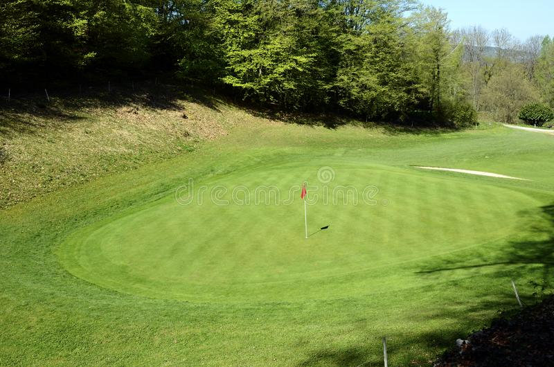 Red flag on Golf in Talloires, Annecy lake, France royalty free stock photos