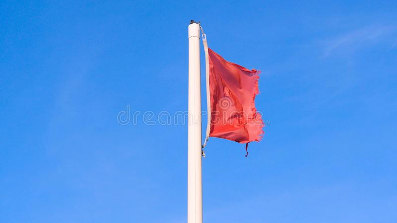 Red flag with the sea, Signal warning. Red flag with the sea, Signal warning on the beach. Concept of: Warning, Sea, Beach, Slow m. Otion stock photo