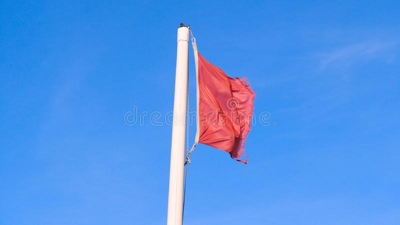 Red flag with the sea, Signal warning. Red flag with the sea, Signal warning on the beach. Concept of: Warning, Sea, Beach, Slow m. Otion stock images