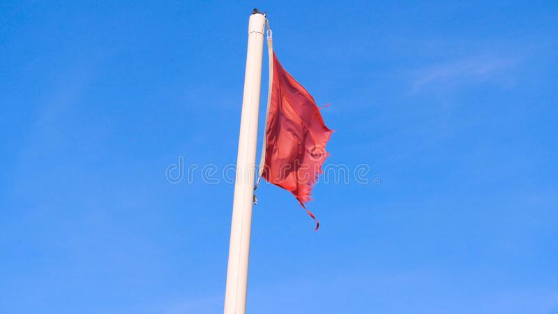 Red flag with the sea, Signal warning. Red flag with the sea, Signal warning on the beach. Concept of: Warning, Sea, Beach, Slow m. Otion stock image