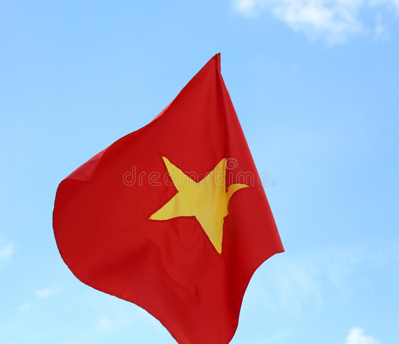 red flag of vietnam with the big yellow star stock photo - image of