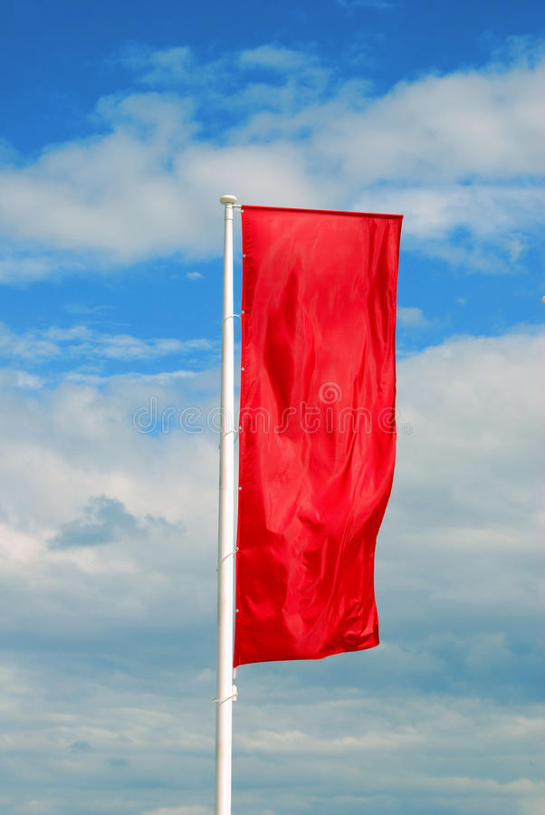 Red flag waves under the wind. Red Soviet Union flag waves under the wind. Blue sky with clouds background. No people royalty free stock photos
