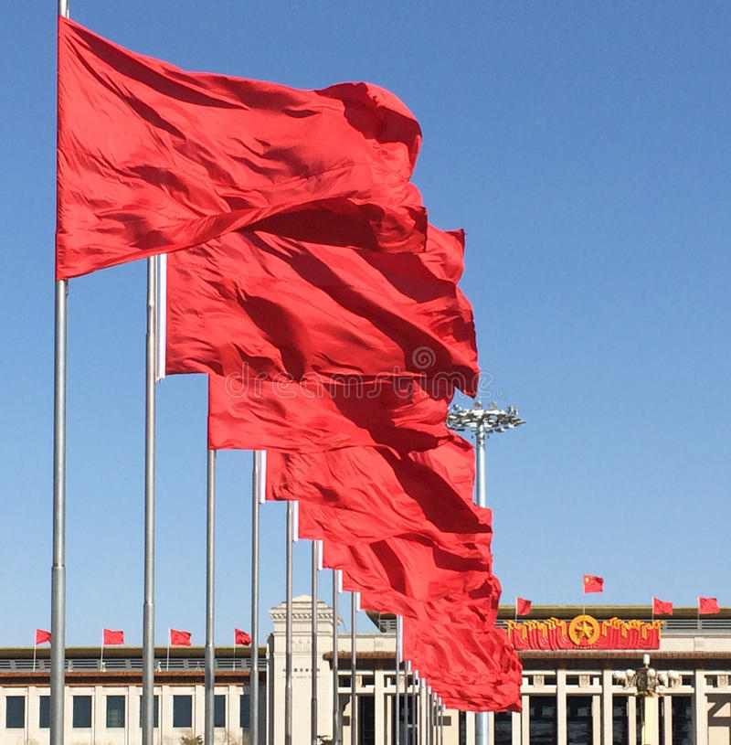 Red flags in Tiananmen Square in Beijing, China stock photography