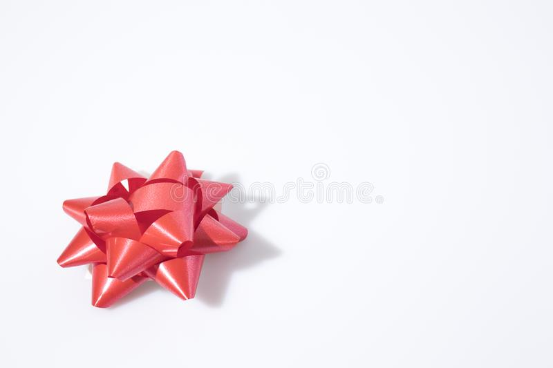 Red flake for wrap gifts in a white background. Composition stock photo