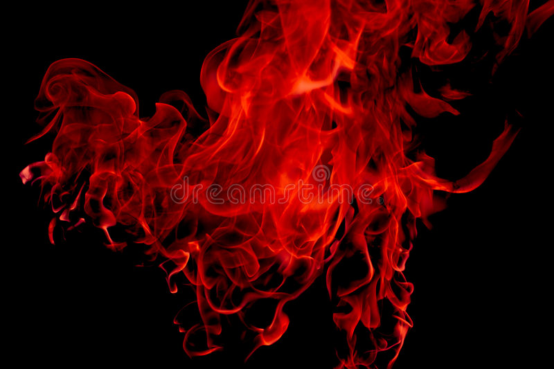 Red flame. Saturated red flame, on black royalty free stock photography