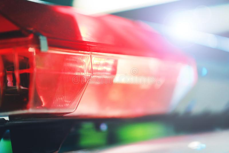 Red flasher on the police car at night. Red light flasher of a p. Olice car. Siren on police car flashing. Police red light and siren on the car in the street royalty free stock photos
