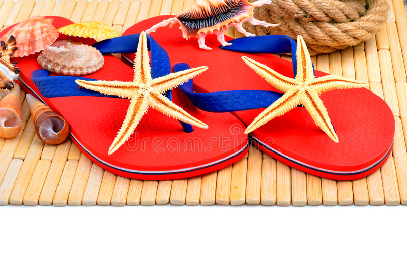 Red flip-flops, slippers with flowers on the wooden background stock image