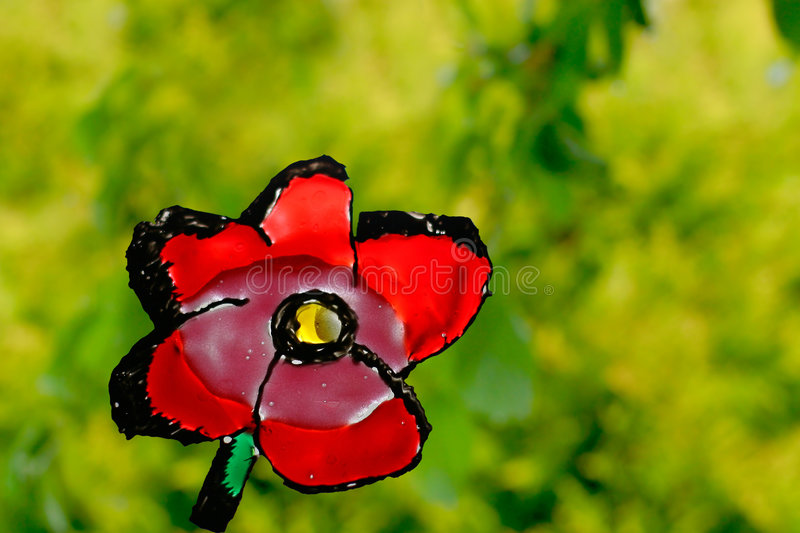 Red flower on green background stock photography