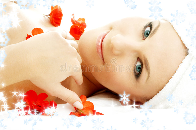 Red flower petals spa with snowflakes #3 stock photo