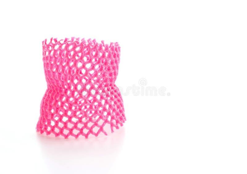 Red foam fruit net. On white background stock photos