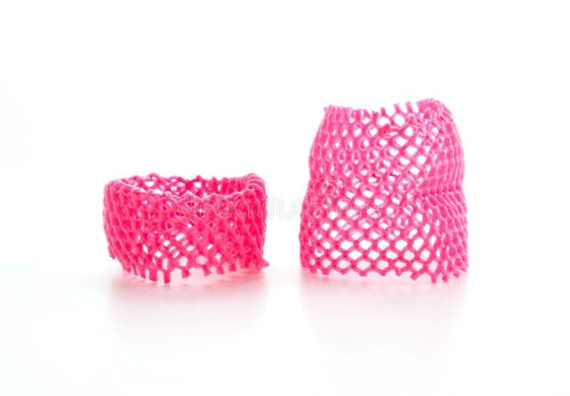 Red foam fruit net. On white background stock image