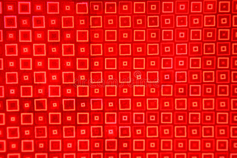 Red Foil Background. With a square pattern. Soft focus royalty free stock photography