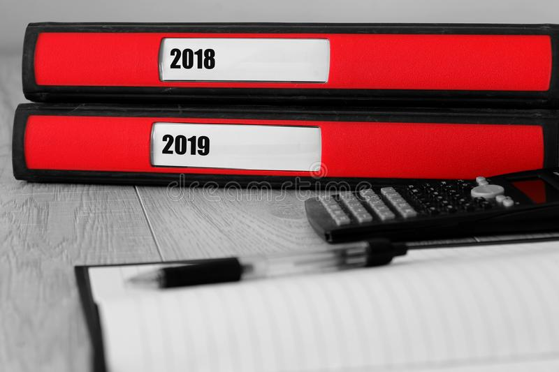 Red folders with 2018 and 2019 written on the label on a desk royalty free stock image
