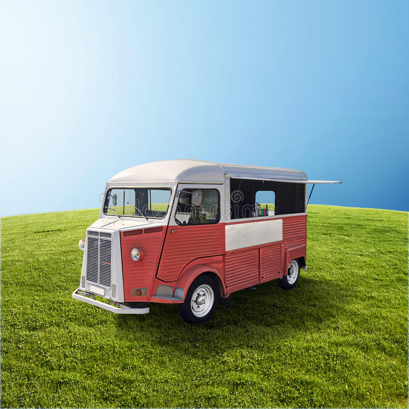 Red food truck on the green field stock image image of for Cuisine on the green